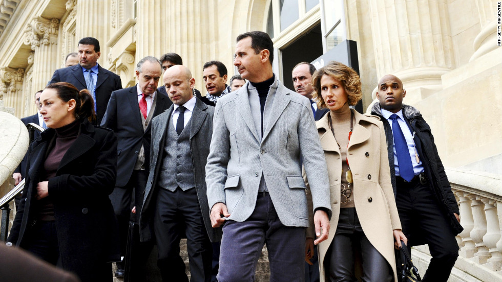 Bashar al-Assad and  Asma al-Assad depart the Claude Monet exhibition in December 2010 in Paris.