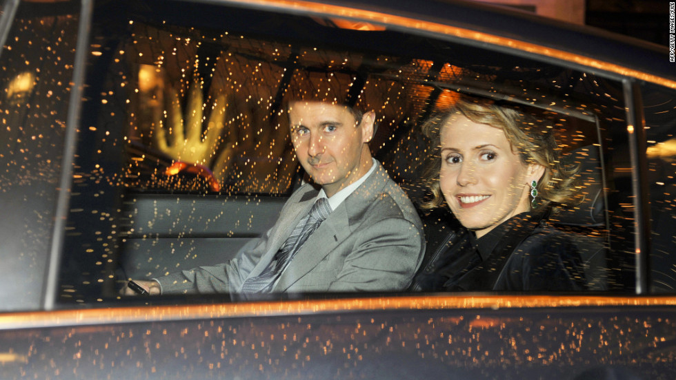 The Syrian first couple visit Paris in December 2010.