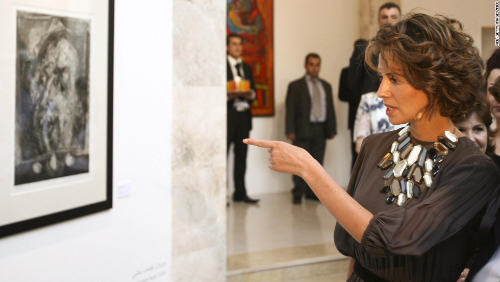 The first lady attends the opening of the Syrian abstract art exhibition in Damascus on July 21, 2008.