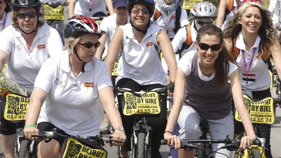 In a ride for peace, Asma al-Assad, right, leads a pack of female bicyclists in the Ras Shamra area of Latakia in Syria on April 8, 2007.