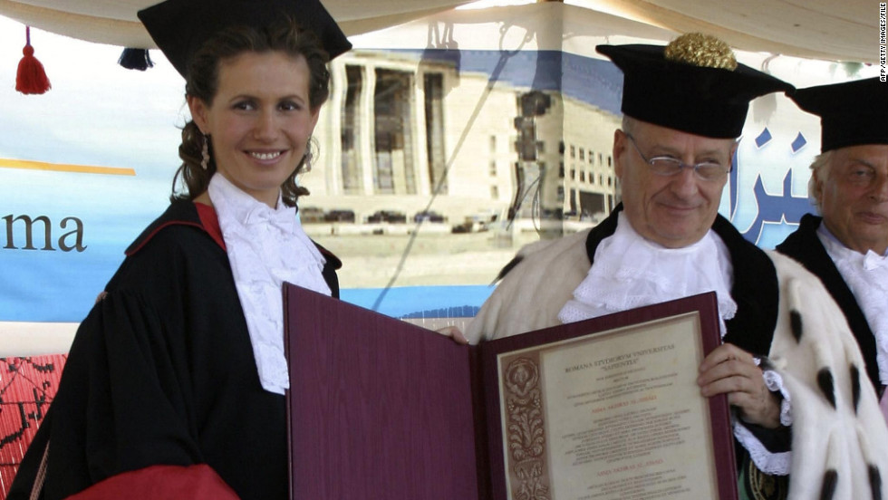Al-Assad gets an honorary doctorate from Roberto Antonelli, the president of Rome's La Sapienza University, on October 20, 2004, in the Syrian city of Ebla.