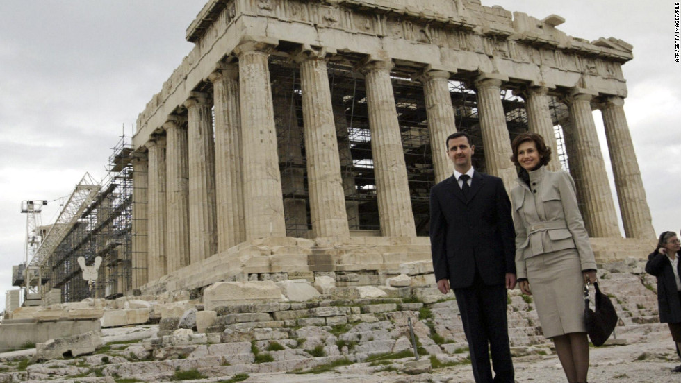Syrian President Bashar al-Assad, left, and Asma al-Assad visit the Parthenon in Athens, Greece, in December 2003.