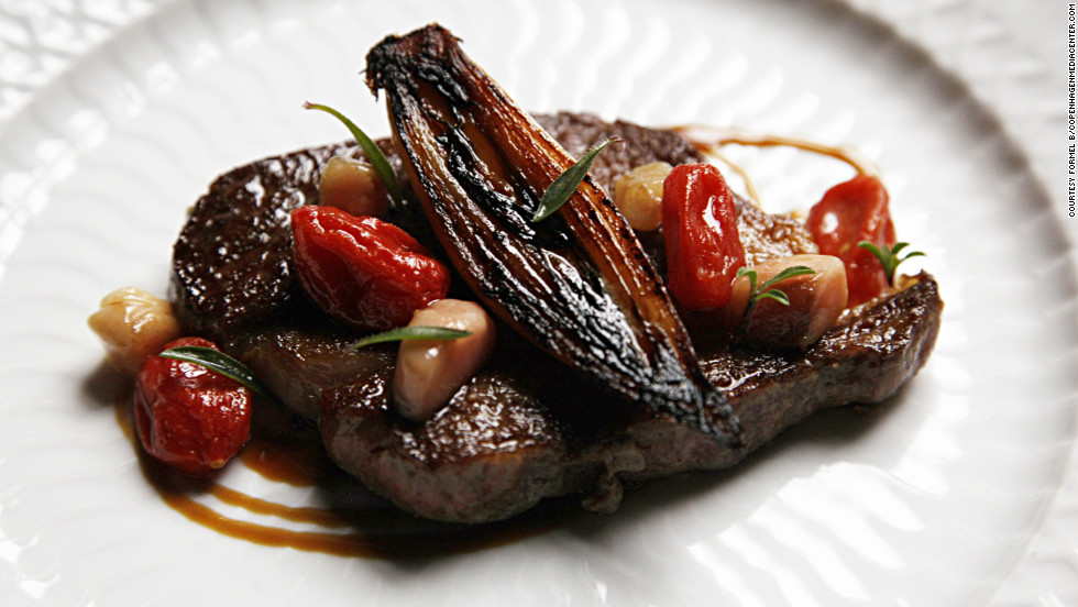 Danish dry aged rib eye with smoked marrow, charred shallot and dehydrated tomatoes.