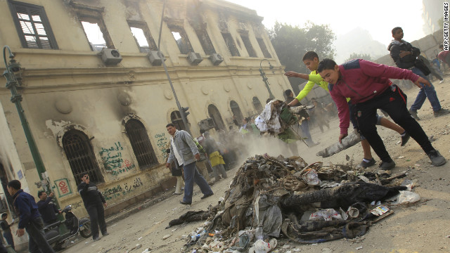 Protesters gather debris near the Institute of Egypt, which was torched during protests, in Cairo on December 20.