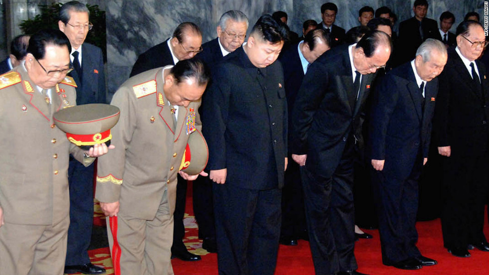 Kim Jong Un, center, son of the late North Korean leader Kim Jong Il, pays his respects to his father with senior officials from the military and Korean Workers' Party.