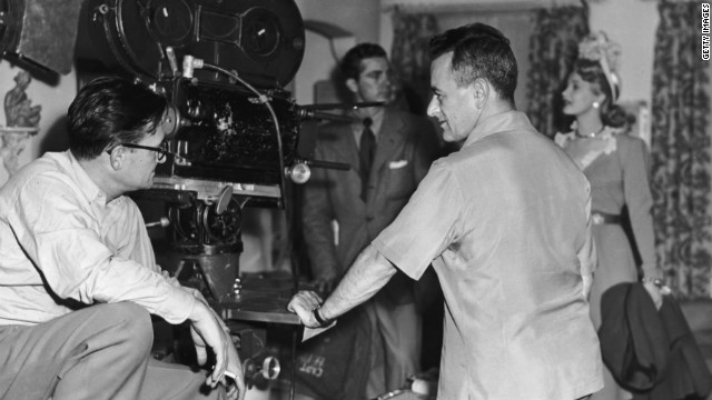 "Cinematographer Gregg Toland, left, William Wyler, Dana Andrews and Virginia Mayo on ""The Best Years of Our Lives"" set."