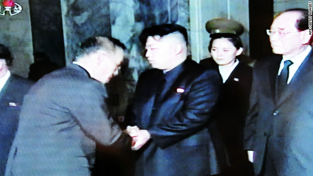 North Korean television Wednesday shows new leader Kim Jong Un receiving condolences from visitors.
