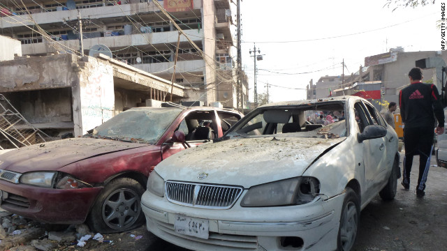 Car windows shattered during a wave of bombings in in Baghdad that killed more than 60 people.