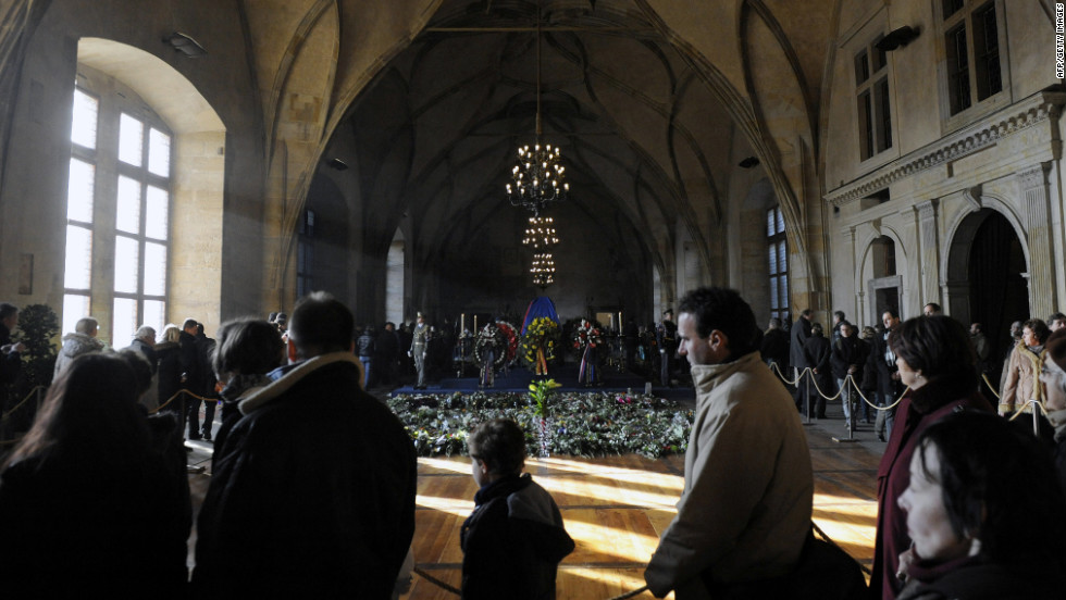 People line up in the Vladislav Hall at Prague Castle as they wait to pass by the former leader's coffin