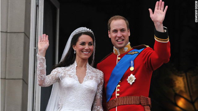 Britain's Prince William and his wife Catherine, Duchess of Cambridge, wave to the crowd from the balcony of Buckingham Palace in London on April 29, 2011, following their wedding.