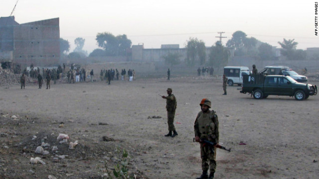 Pakistani soldiers cordon-off the site of a suicide car bombing in Bannu.