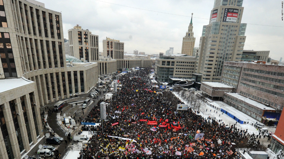 Thousands of protesters flood through Moscow streets, calling for fair elections.