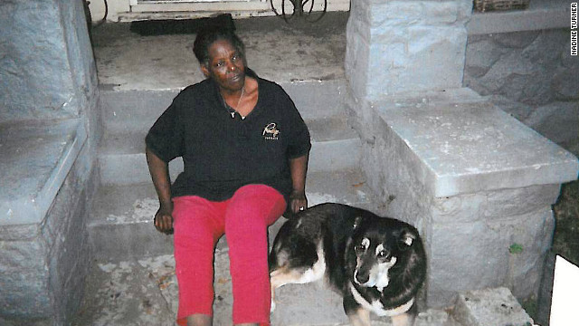 Nadine Turner rests beside her dog, Giorgio, in Atlanta.