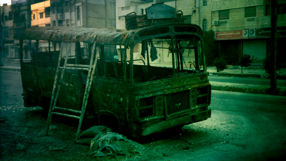 A wrecked bus lies abandoned in Baba Amr in Homs.