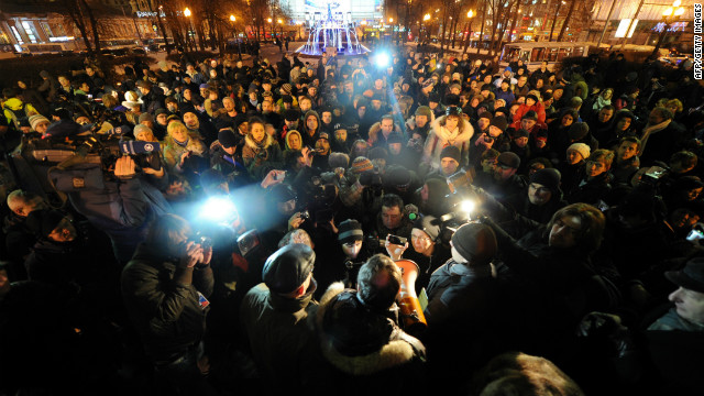 Demonstrators rally Thursday against the detention of activist Sergei Udaltsov at the Pushkinskaya Square in central Moscow.