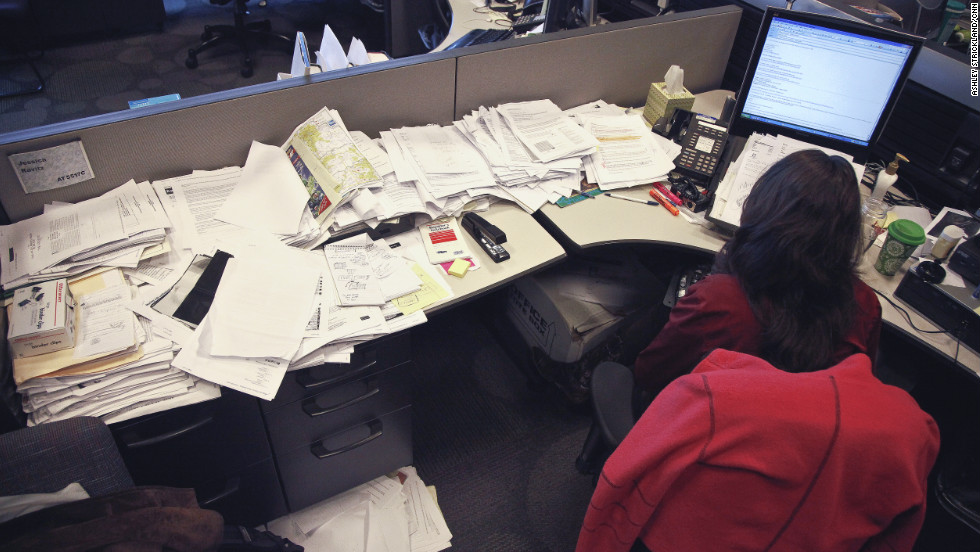 CNN.com writer Jessica Ravitz works surrounded by papers documenting three years' worth of stories.