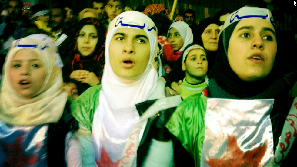 A night demonstration takes place in the Baba Amr neighborhood.