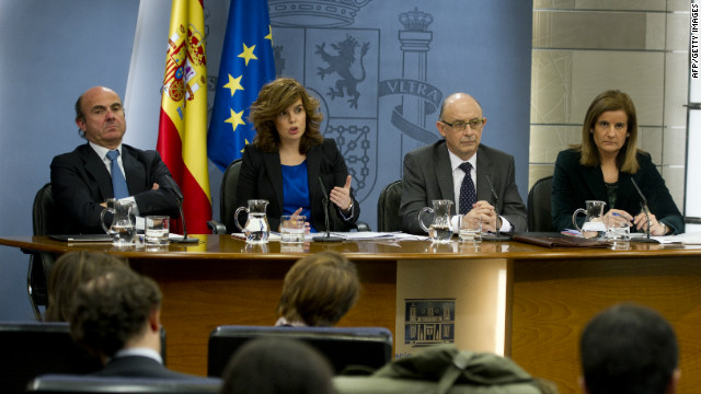 Spain's Minister of Economy and Competitiveness Luis de Guindos, First deputy Prime Minister Soraya Saenz de Santamaria, Minister of Budget and Public Administration Cristobal Montoro Romero and Minister of Employment and Social security Maria Fatima Banez Garcia speak to the press Friday.