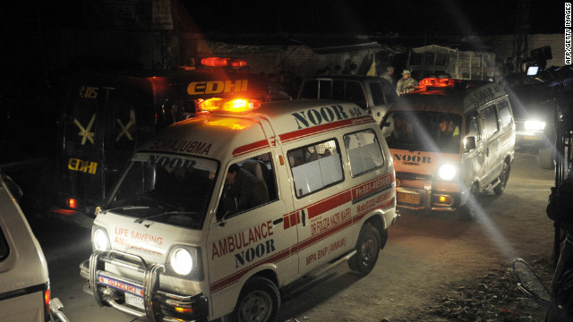 Ambulances transport victims from the site of the car bomb blast in Quetta on Friday.
