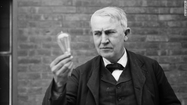Thomas Alva Edison in 1911 with his famous light bulb