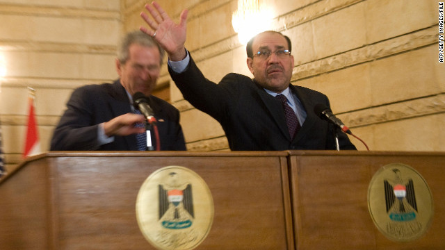 Iraq's Prime Minister Nuri al-Maliki tries to block U.S. President George W. Bush after an Iraqi man threw his shoes at Bush in 2008.
