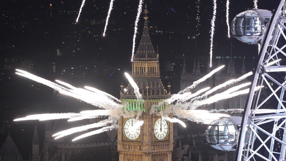 Festive fireworks light up the London skyline and Big Ben just after midnight as thousands of people lined the banks of the River Thames.