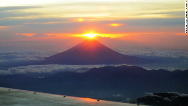 The sun rises on New Year's Day behind from Mt. Fuji in Japan's Yamanashi prefecture on January 1.