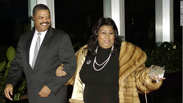 Aretha Franklin and William Wilkerson arrive at a dinner for Kennedy Center honorees in Washington in December 2006.