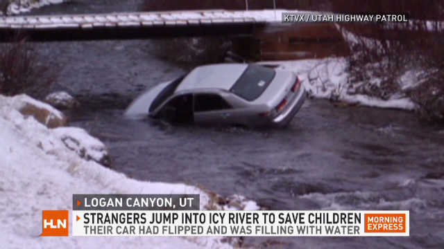 Strangers rescue kids from icy river