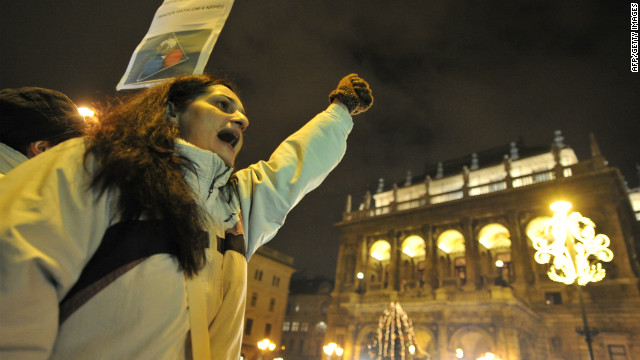 A woman shouts an anti-government slogan in front of the building of the Hungarian National Opera on January 2, 2012.