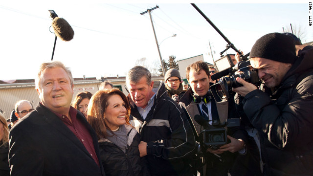Reporters crowd around Michele Bachmann and her husband, Marcus, in Ames, Iowa. Roland Martin says political commentators exaggerate Iowa's significance.
