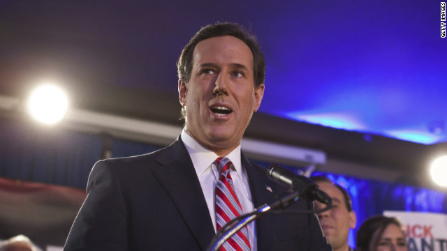 GOP presidential hopeful Rick Santorum addresses a crowd of supporters Tuesday night in Johnston, Iowa.