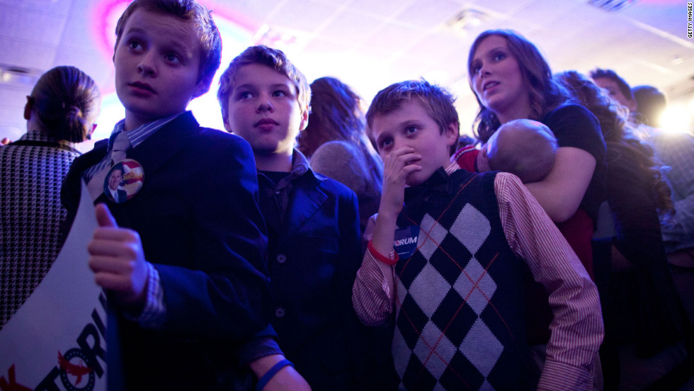 Oh, and what's this -- is the younger generation jumping aboard the sweater vest train? A member of the Duggar family supports Santorum's style on caucus day in Johnston, Iowa.