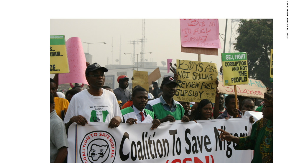 "Adjarho David Obaro, who was in Nigeria for the holidays, took photos of the protests near King's Square in Benin City in January 2012. He said there were thousands of protesters there from different backgrounds. ""I saw raw anger in the eyes of the protesters,"" said Obaro."