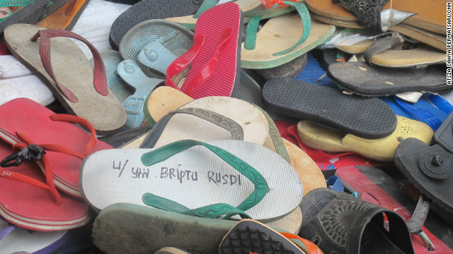 A donated flip-flop bears the name of 1st Brig. Ahmad Rusdi, the policeman who accused a boy of stealing them.