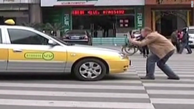 Man helps Chinese cross streets safely