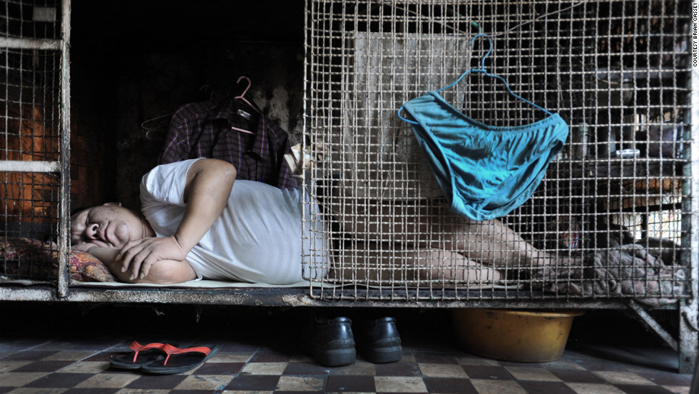 ... as these images taken earlier this year of people in Hong Kong living in nothing more than cages attest to.