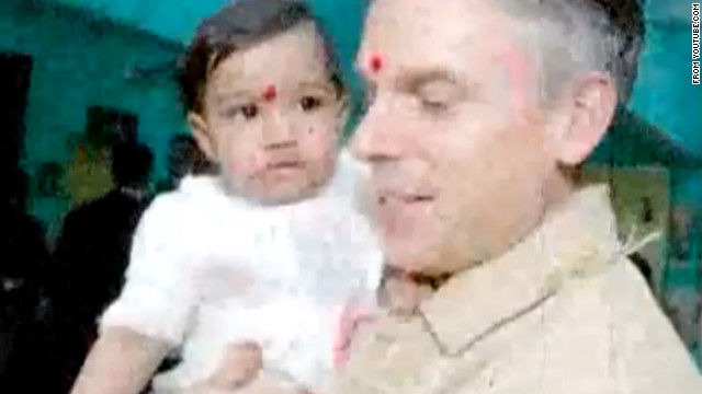 The vdeo shows Jon Huntsman with Asha Bharati, wearing the red tikka, a mark associated with the sacred in Hinduism.