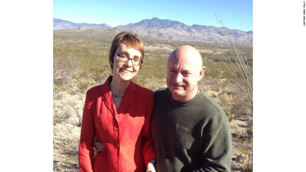 Gabrielle Giffords and her husband, Mark Kelly, stand at the Gabe Zimmerman Trailhead memorial site on Saturday, January 7. Zimmerman, one of the congresswoman's aids, was killed in the shooting.