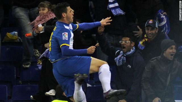 Alvaro Vazquez celebrates his late equalizer for Espanyol against champions Barcelona.