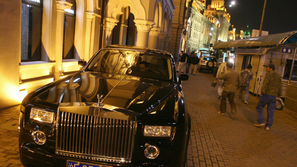 China is now one of Rolls-Royce's biggest markets. Here a Phantom is parked outside a luxury goods store on Shanghai's Bund in 2006.