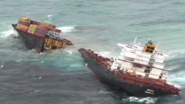 Debris spews from split cargo ship