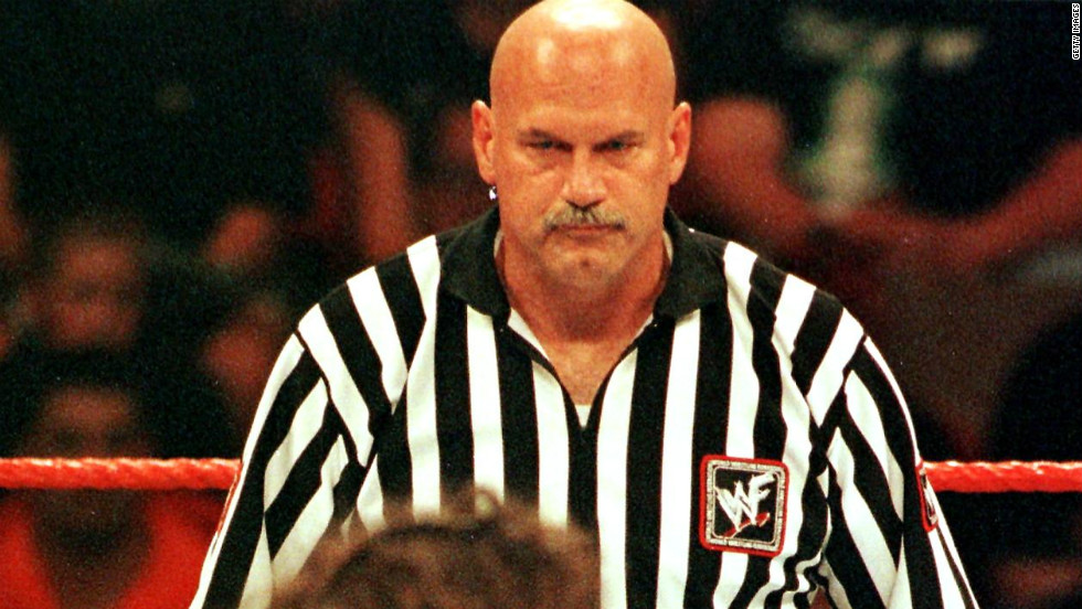 One-time Minnesota governor, former professional wrestler and guest referee Jesse Ventura, center, watches the action during the World Wrestling Federation SummerSlam in 1999 in Minneapolis.