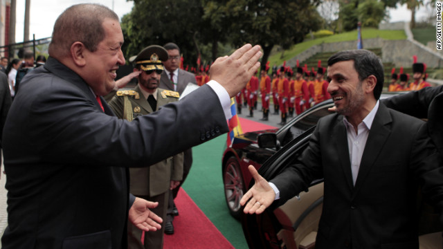 Venezuelan President Hugo Chavez greets his Iranian counterpart Mahmoud Ahmadinejad in Caracas on Monday.