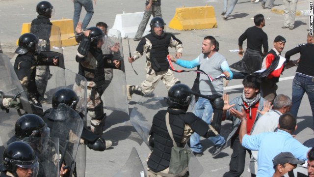 Iraqi protestors clash with Iraqi riot police on February 25, 2011 at Baghdad's Tahrir square