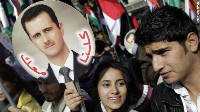 Syrian supporters of President Bashar Assad rally in Damascus on January 9, 2012.