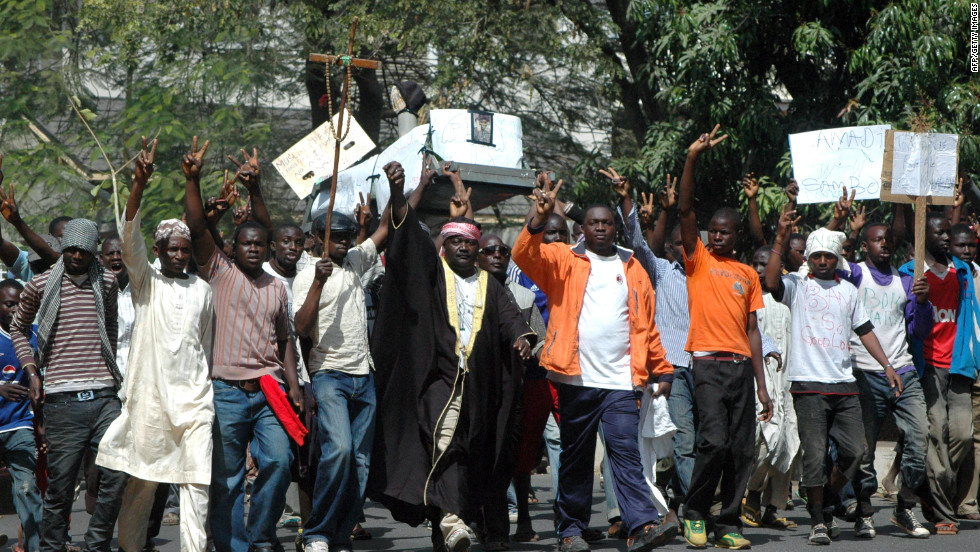 Protesters carry a mock coffin of the Nigerian President Goodluck Jonathan.