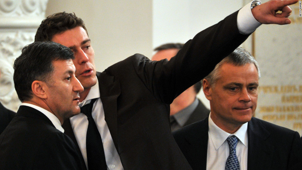Newly elected Russian lawmaker and former tennis star Marat Safin, center, gestures as he speaks in the Kremlin in December 2011.