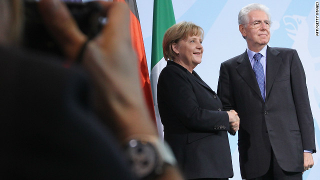 German Chancellor Merkel and Italian Prime Minister Monti after speaking to media at the Chancellery on in Berlin.