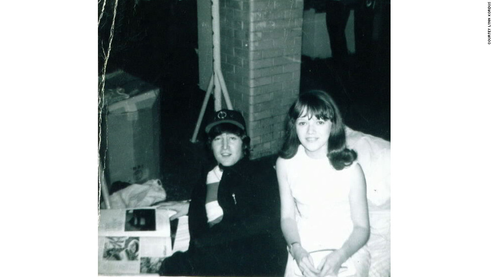 "iReporter Lynn Kordus said her most memorable ""Kodak moment"" was with the Beatles in 1965. Here she poses with John Lennon while he thumbs through a magazine. <a href=""http://ireport.cnn.com/topics/726798"">See more Kodak moments on CNN iReport.</a>"